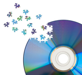 CD / DVD cut by jigsaw puzzle